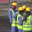 Migrant workers on road building site — Stock Video #75054875