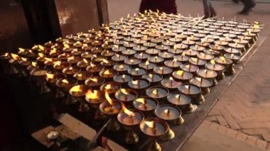 Flames of candles near the Boudhanath stupa — Stock Video