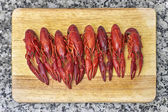Red river crayfish on cutting board — Stock Photo
