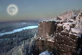 Full moon at winter mountains. — Stock Photo