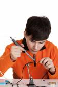 A boy learning to solder wires — Stock Photo