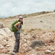 Adult brunette woman hiking and backpacking — Stock Photo #70791735