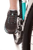 Close up foot of the cyclist pedalling bike — Stock Photo
