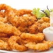 Plate of fried in batter squid  with sauce. — Stock Photo #75626775