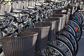 Bicycles with baskets  for rent docking station in Copenhagen, D — Stock Photo