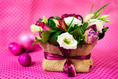 Flower arrangement on a pink background with polka dots — Stock Photo