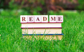 Book stack with read me sign on the top — Stock Photo