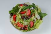 Bowl of salad with fresh vegetables on white backgroound — Stock Photo