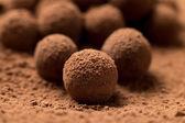 Group of round dark chocolate truffles — Stock Photo