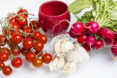 Cherry tomatoes and radsihes — Stock Photo