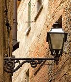 Old streetlight hanging — Stockfoto