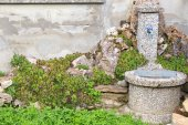 Old fountain in the green — Stock Photo