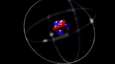 Atom single high energy shake vibrate nucleus proton neutron electron loop — Stock Video