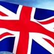 UK Britain Union Jack Flag Closeup Waving Against Blue Sky Seamless Loop CG — Stock Video #69474949