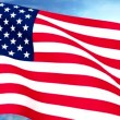 USA US Flag Closeup Waving Against Blue Sky Seamless Loop CG — Stock Video #69482305