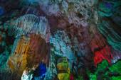 Mountain inside the cave with multicolored lighting in Vietnam. — Stock Photo