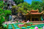 Buddhist Palace and the water lilies in the water in Vietnam.Asia. — Stock Photo