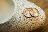 Very beautiful engagement ring and bridesmaid shoes — Stock Photo