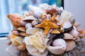 Very beautiful engagement ring and shells — Stock Photo