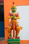 Multi-colored sculpture of a warrior with a sword with a green face at a Buddhist temple. Nakhon Ratchasima. Thailand. — Stock Photo