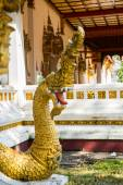 Golden dragon with open mouth.Sculpture at the temple. Laos, Vientiane. — Stock Photo
