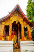 Buddhist temple with gold.The gold Buddha statue.Luang Prabang.Laos. — Stock Photo