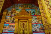 The door and wall painting.Buddhist temple with gold.Luang Prabang.Laos. — Stock Photo