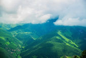 Beautiful blue-green mountains in the mist.Cloudy.Summer.The Caucasus. .Russia. — Stock Photo