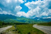 Mountains in the clouds in cloudy weather.Road.Landscape.   The Caucasus. .Russia. — Stock Photo
