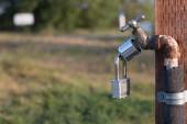 Locked hose bibb in a California Park — Stock Photo