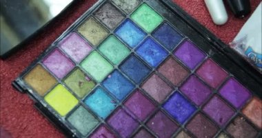 Cosmetics. Eyeshadows on table. — Stock Video