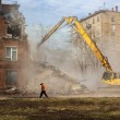 Excavator demolishes old school building — Stock Photo #69305873