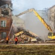 Excavator demolishes old school building — Stock Photo #69305911