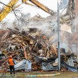 Excavator demolishes old school building — Stock Photo #69306059
