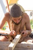 Ancient Roman jeweler grinds jewelry — Stock Photo