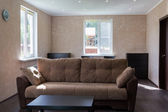 Sofa in living room of a country house — Stock Photo