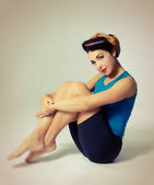 Woman sitting in sport clothes in retro style — Stock Photo