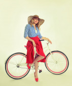 Girl with a bicycle in a retro style — Stock Photo