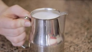 Barista stirs the milk and making cappuccino. Close-Up. — Stock video