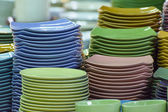 Stack of multicolored plates its was tile — Photo