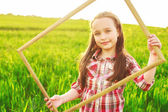 Little girl in the field with frame. portrait — Stock Photo