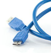 Blue usb 3.0 cable with micro B connector isolated on white back — Stock fotografie