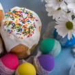 Kulich, traditional Russian Ukrainian Easter cake with colored eggs and flowers — Stock Photo #69465087