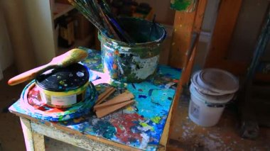 Paint cans in art studio — Stockvideo