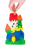 Wooden castle puzzle toy made of colour blocks on a  isolated background. — Stock Photo
