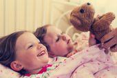 Beautiful little girls (sisters) in the crib. — 图库照片