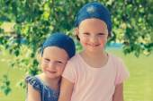 Cute funny little girls (sisters) smile. Selective focus. — Stock Photo