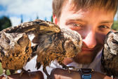 Man holding on a hand of beautiful owls — Stock Photo