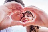 Mature couple with love sign — Fotografia Stock