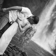 Couple travel near the waterfall — Stock Photo #75319401